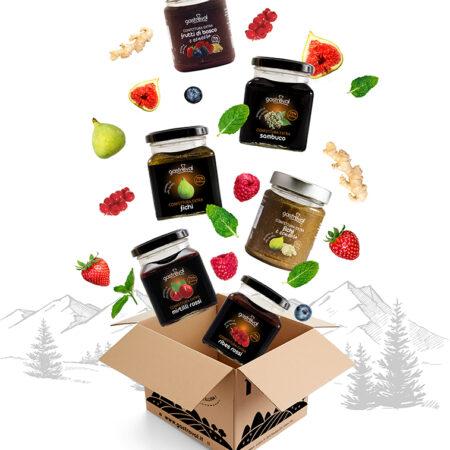 scatola di cartone con vasetti marmellata di vari gusti